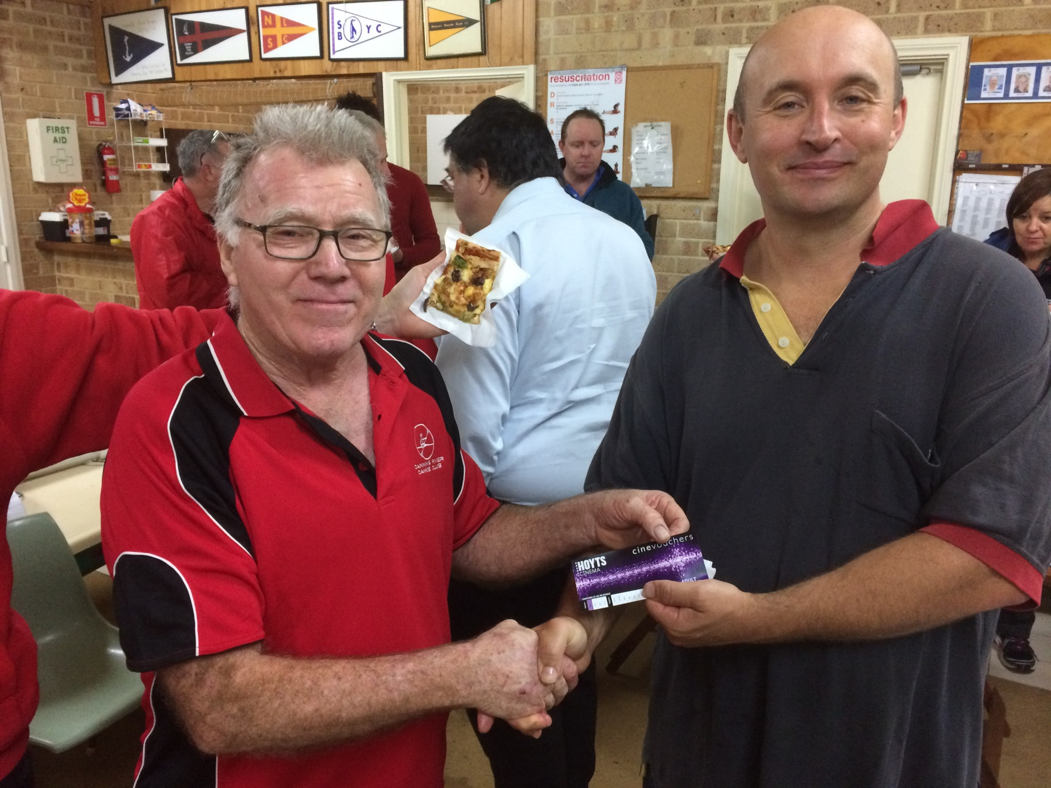 Tuesday 7th July 2015 : Club member David GArdiner presenting tonights winner Mike Galanty with a movie voucher