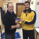 Tuesday 21st July 2015 : Club member Brett Young Presenting tonight's winner Simon O'Sullivan with a movie voucher
