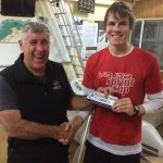 Tuesday 18th August 2015 : Club member Joe Wilson presenting tonights winner Liam Thompson with a movie voucher