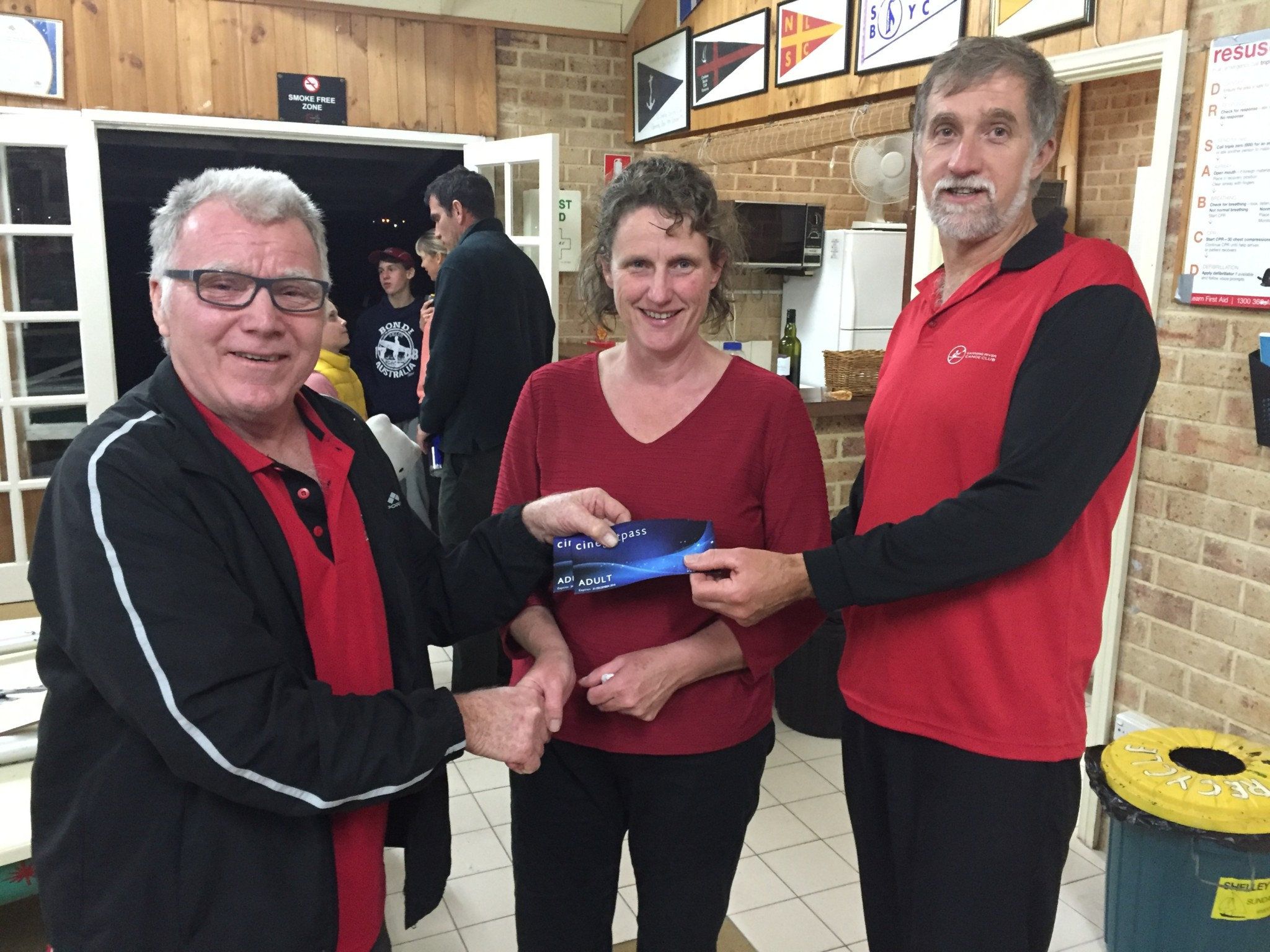 Tuesday 5th July, Club member David Gardiner presenting movie vouchers to tonights winners Steve and Cindy Coward
