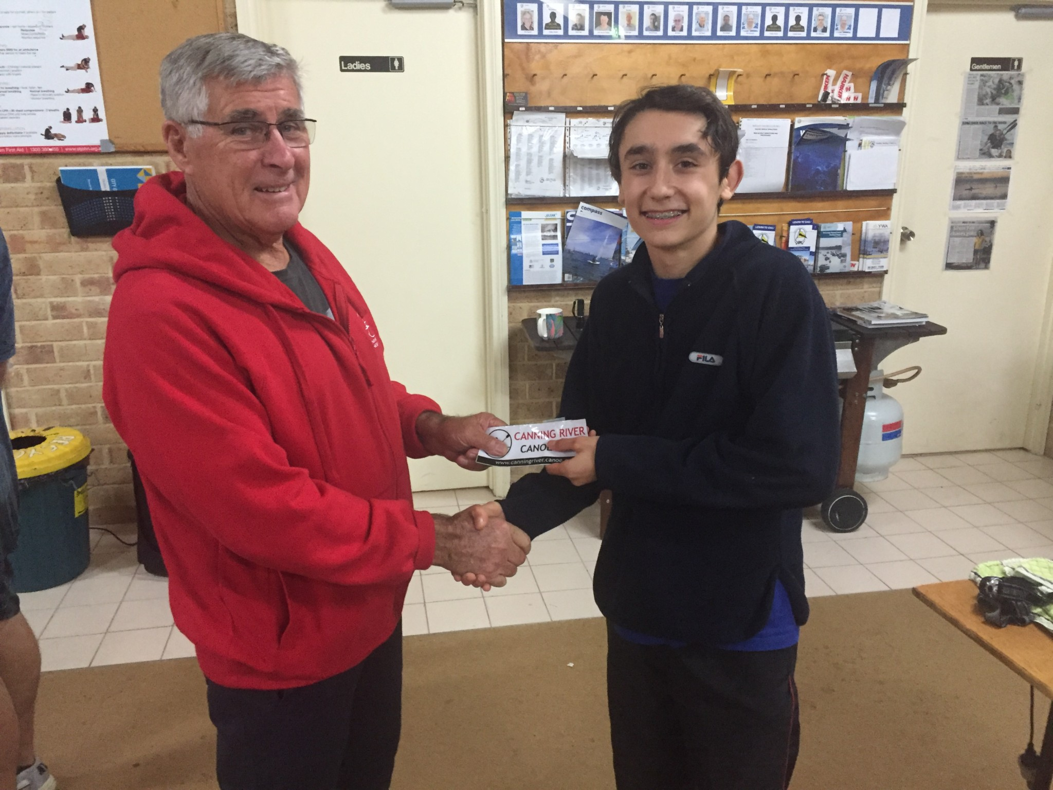 Tues 19th July 2016 : Tonight's photo shows club member Joe Wilson presenting Luke Egger with a movie voucher