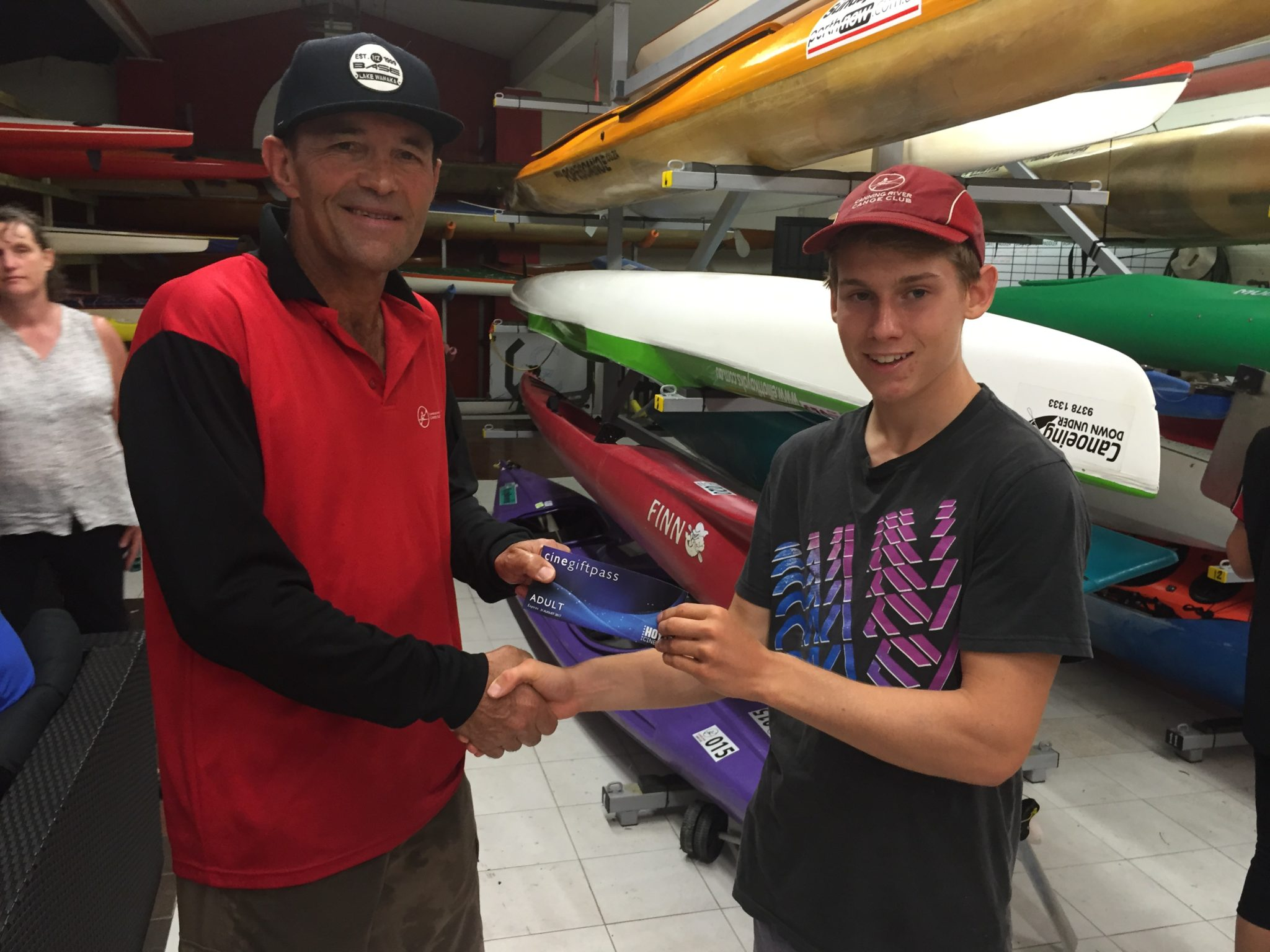 Tues 14th March 2017, Tom Green just back from winning medals at the Kayaking Nationals in Sydney presenting Doug Hodson with a movie voucher