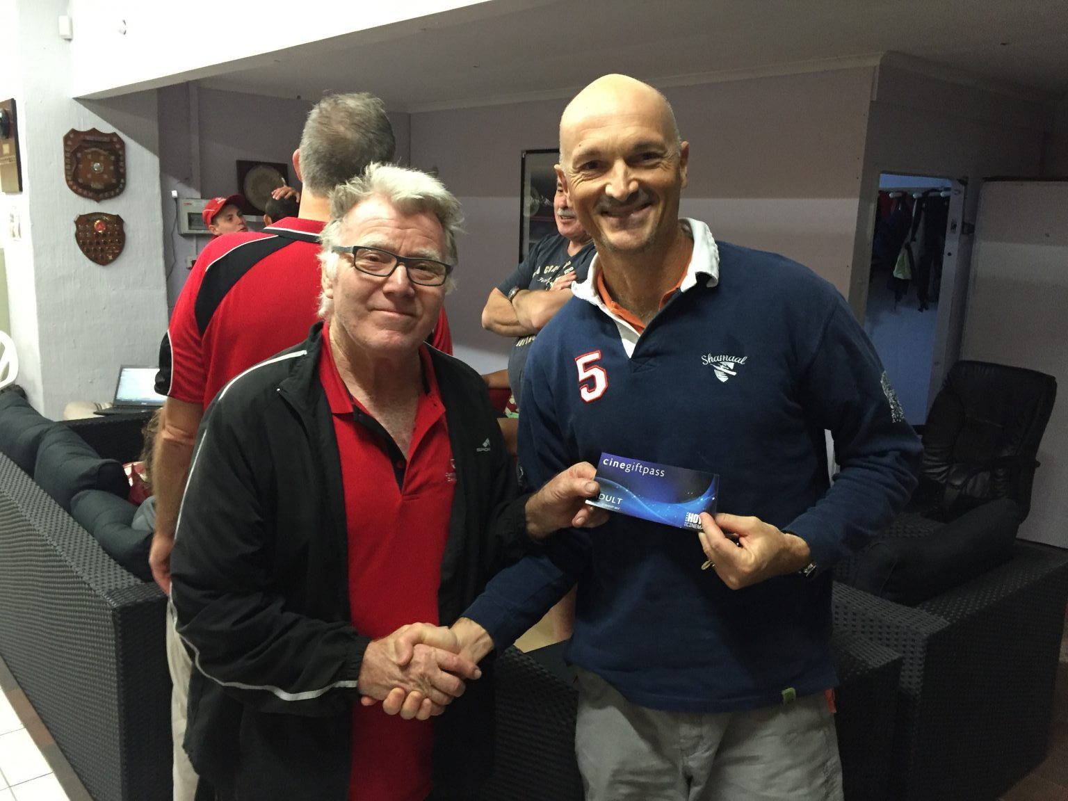 Tues 21st March 2017 : Tonights photo shows club member David Gardiner presenting Carlo with a movie voucher.