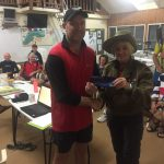 Tues 25th April 2017 Anzac Day Club Night : Tonight's photo shows Club Secretary Judith Thompson in her Anzac gear presenting Simon with a movie voucher.