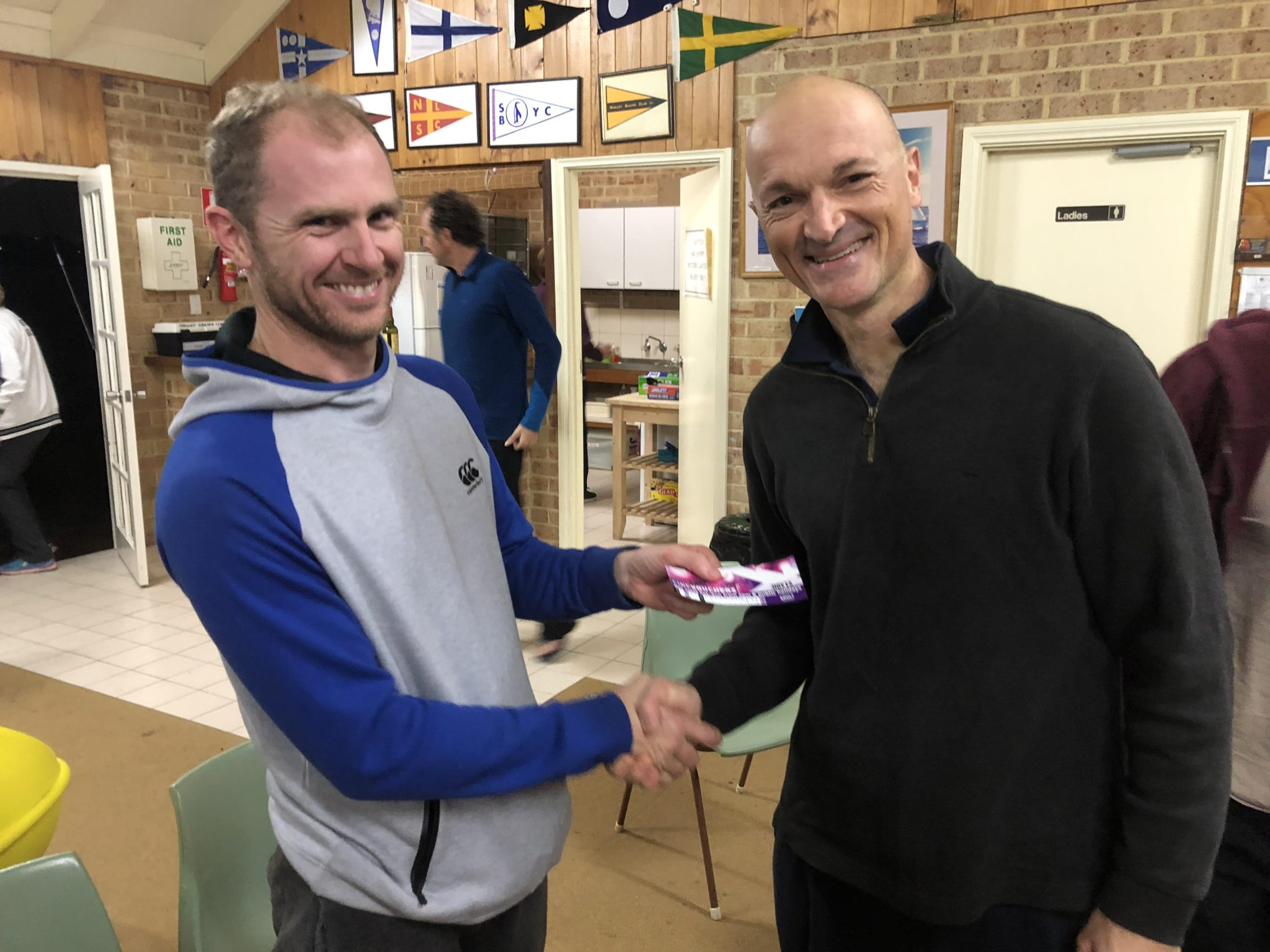 Tues 17th July 2018 : Tonight's photo shows club member Mike Laloli, who claims he dragged Carlo around the course presenting tonight's winner Carlo Cottino with a movie voucher