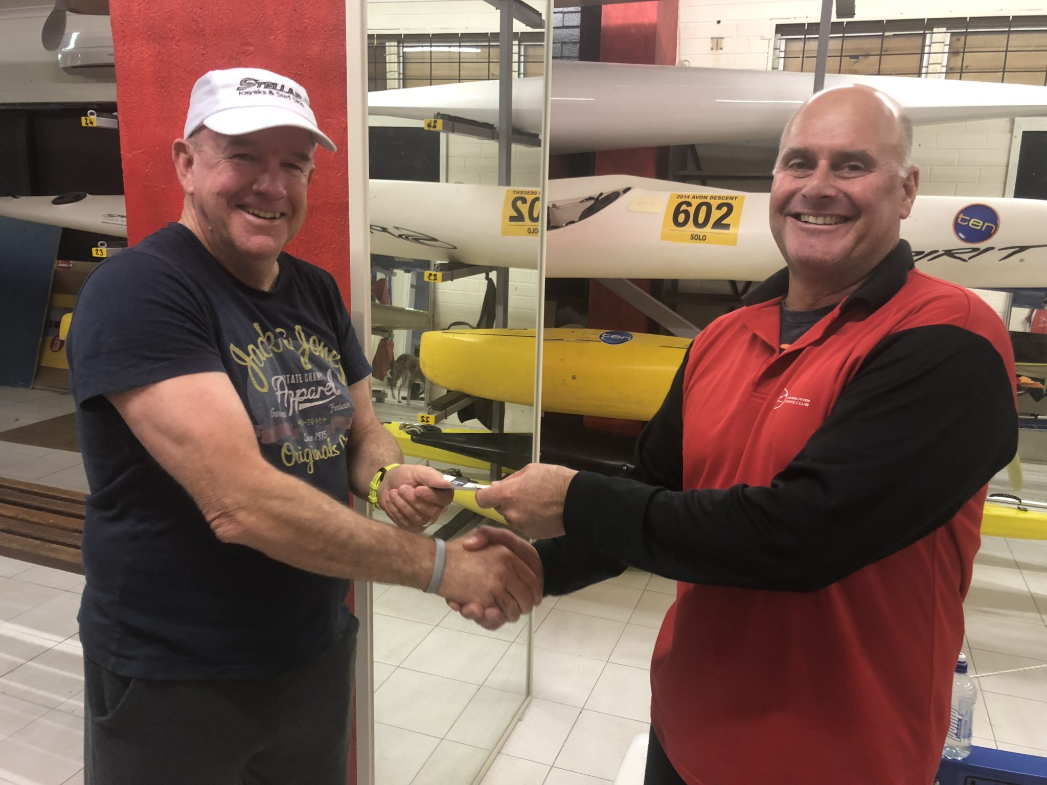 Tues 23rd October 2018 : Tonight's photo shows club member Peter Burge presenting Steve Mitchinson with a movie voucher