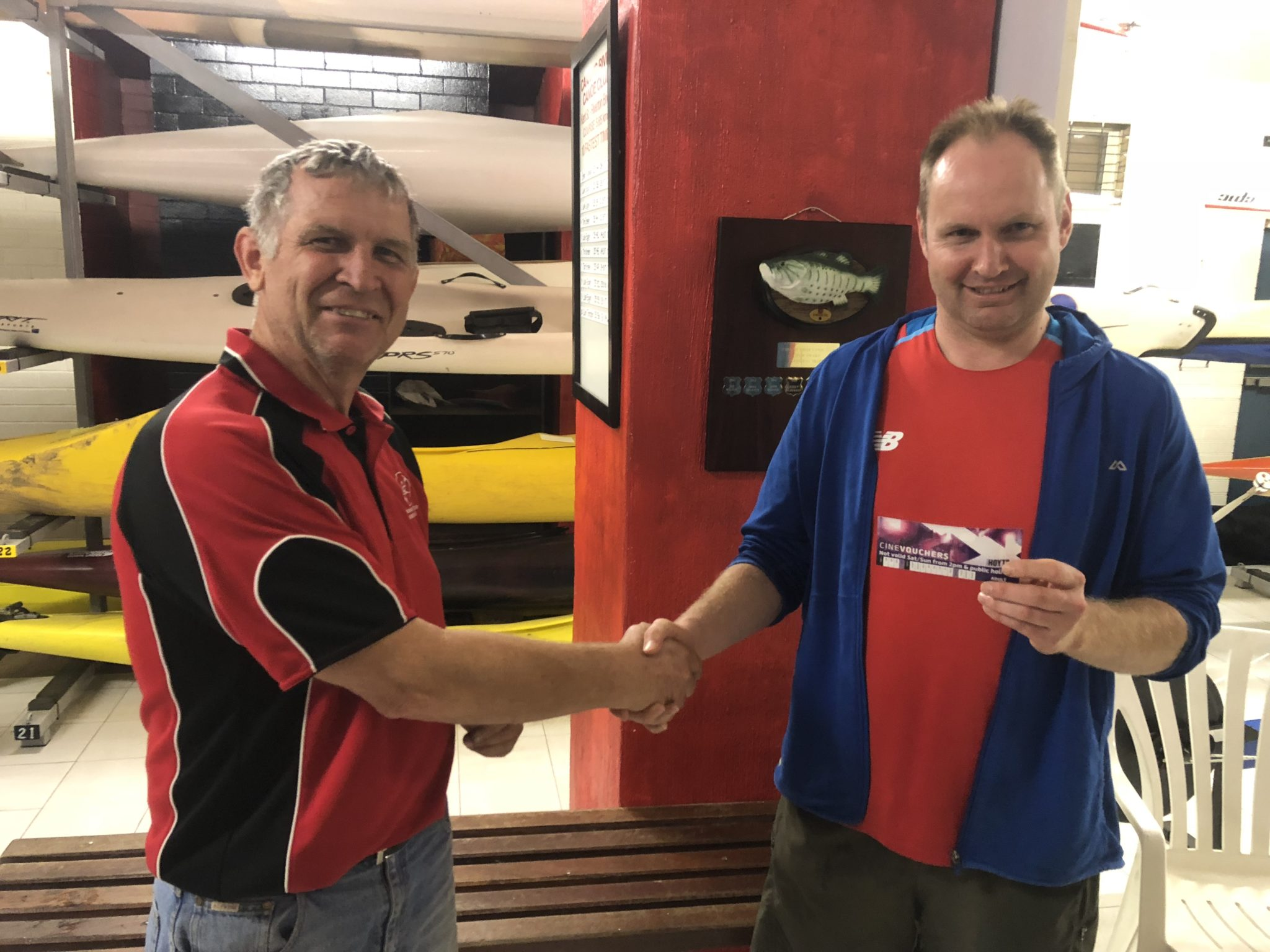 Tues 27th November 2018 : Tonight's photo shows club member Dave Brown presenting Kieran English with a movie voucher.