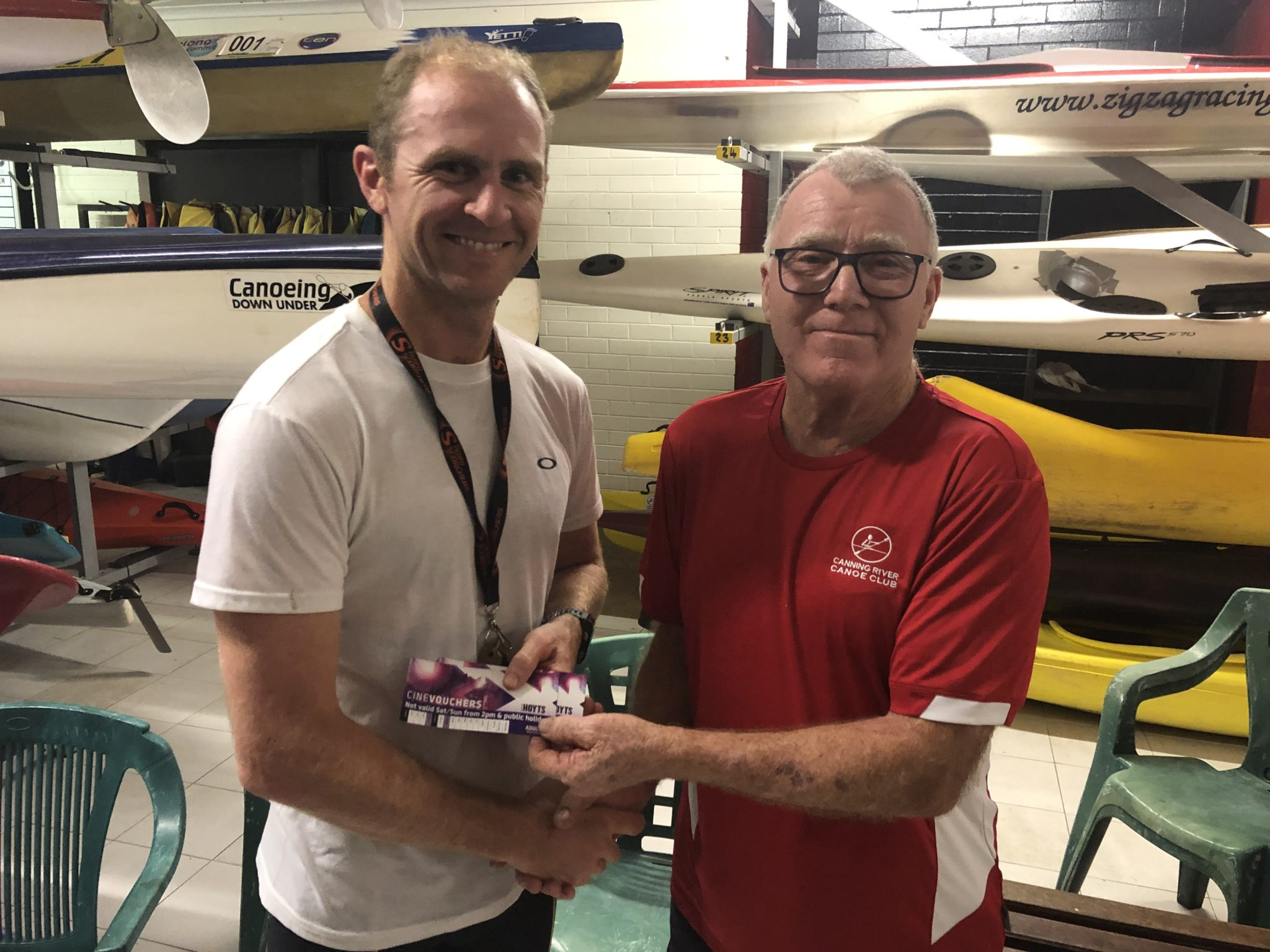 Tuesday 12th February 2019 : Tonight's photo shows club member Les presenting Mike Laloli with the winners movie voucher.