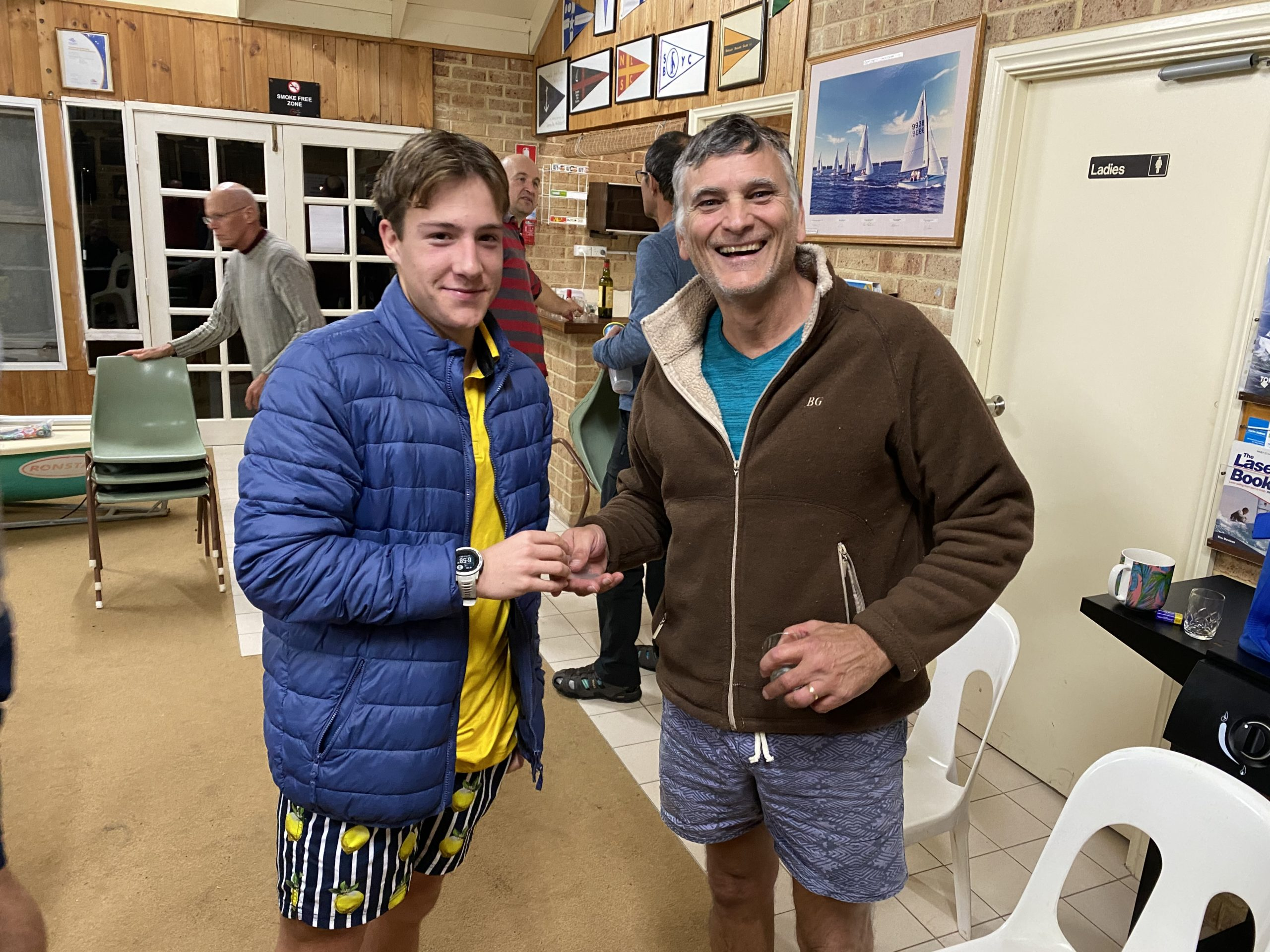 Tuesday 16th June 2020 : Tonight's photos shows club member Noah Boldy who also set the 4th ever fastest time on the course tonight presenting Peter Farrell with a movie voucher.