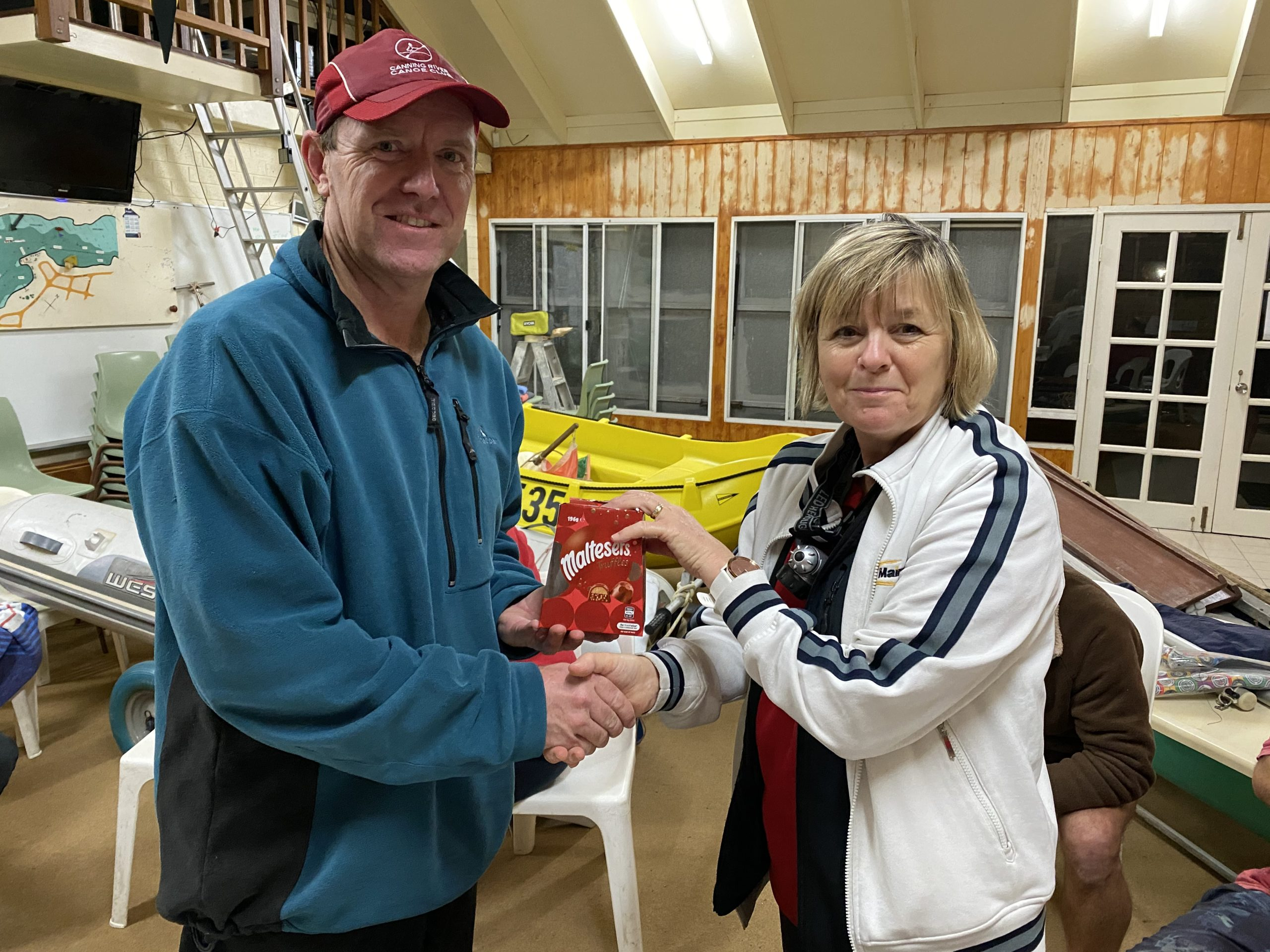 Tuesday 30th June 2020 : Tonight's photos shows club Secretary Judith Thompson presenting Simon O'Sullivan with a movie voucher.